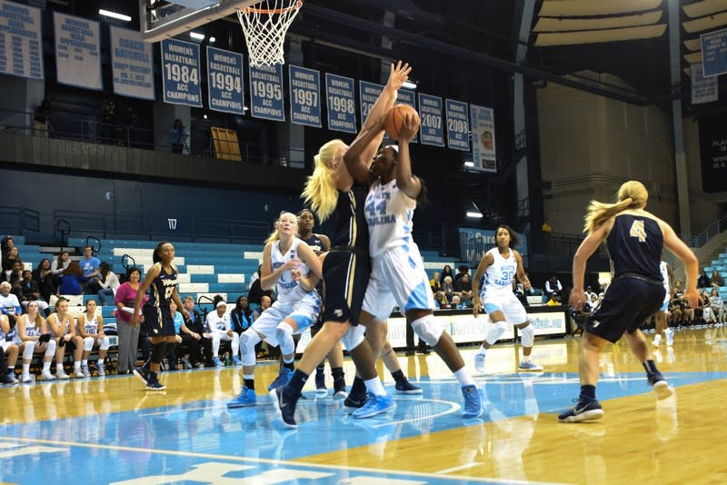 Center Janelle Bailey (44) attemps a shot against Wingate on Wednesday in Carmichael Arena.