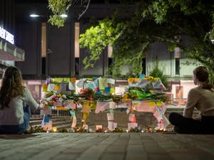 A makeshift memorial was set up in the Pit on Monday as students and faculty mourned the losses of the weekend. Passersby left notes of encouragement and flowers.