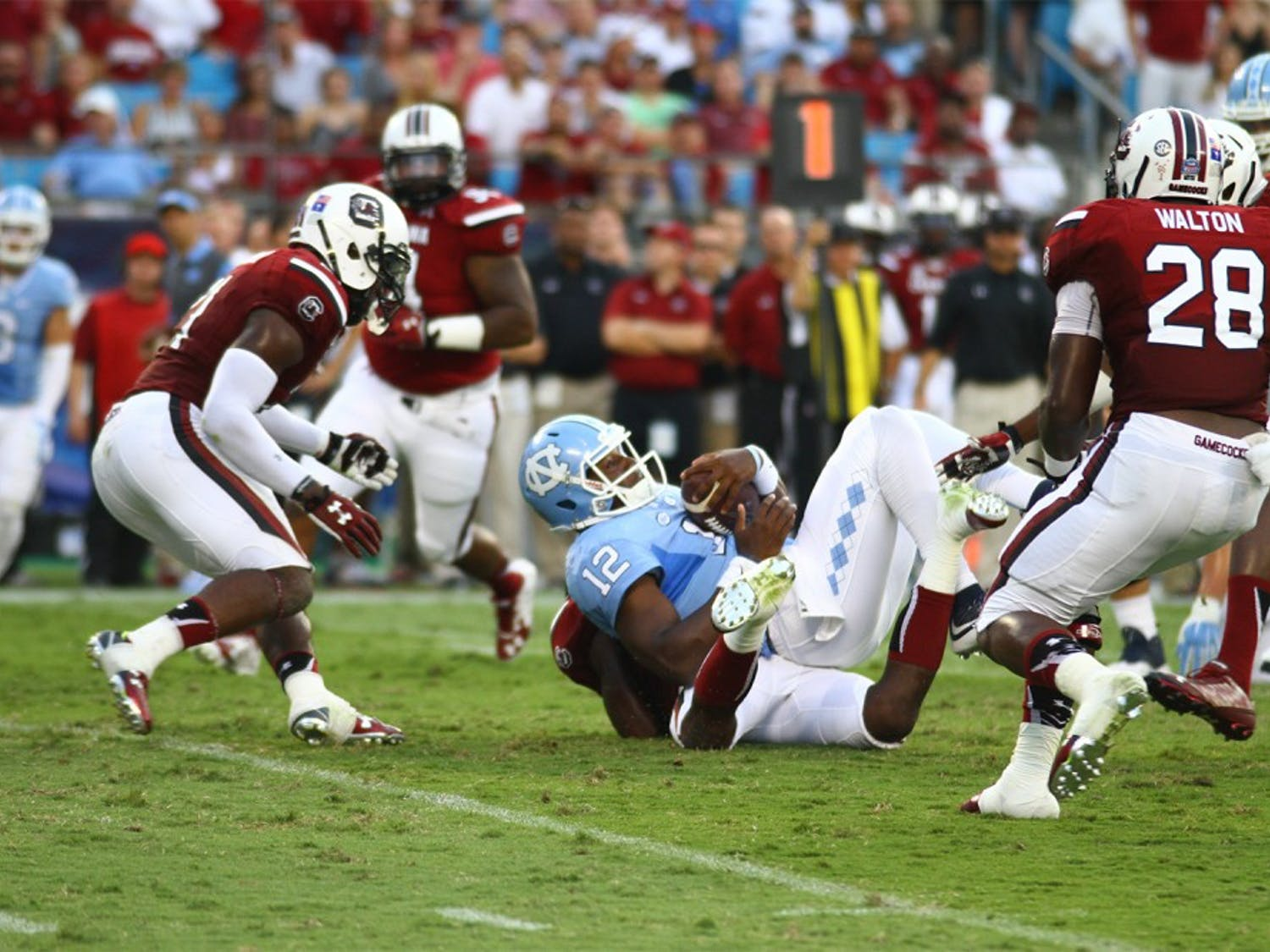 South Carolina surrounds senior quarterback Marquise Williams (12). Williams threw three interceptions on Sept. 3 in a 17-13 loss against the Gamecocks.