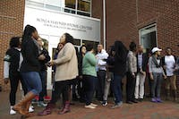 Students from the Black Student Movement and the Board of Governors Democracy Coalition meet in front of the Sonja Hanes Stone Center on Thursday. The students are advocating to keep the building's funding, which is currently under review by the Board of Governors.