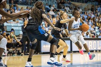 UNC senior guard Shayla Bennett (22) dribbles past Duke University sophomore guard Meila Goodchild (3) in Carmichael Arena on Sunday, March 1, 2020. The Blue Devils beat the Tar Heels 73-54.