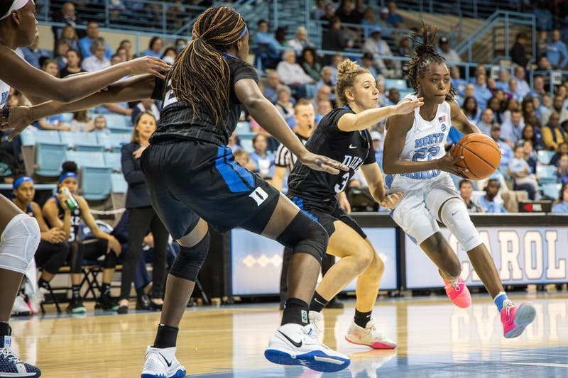 UNC senior guard Shayla Bennett (22) dribbles past Duke University sophomore guard Meila Goodchild (3) in Carmichael Arena on Sunday, March 1, 2020. The Blue Devils beat the Tar Heels 73-54.