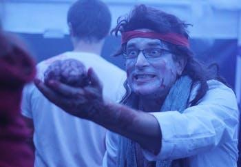 Tom Davis scares people with a pretend brain as they walk through a haunted hospital at the Hillsborough Spooktacular on Saturday evening. The annual event, hosted by the Orange County Department of Environment, Agriculture, Parks & Recreation, featured activities for children and families.