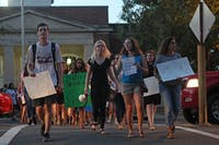 Demonstrators march from the Peace and Justice plaza on Franklin Street on Friday evening.