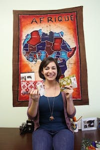 """Mary Kathryne Hutton, a 2009 UNC graduate and internship coordinator at ABAN, holds some of ABAN's products.  ABAN is a group which empowers and helps Ghanan street girls get off the streets by teaching them a trade.  """"The first class of women will be graduating at the end of the summer,"""" said Hutton."""