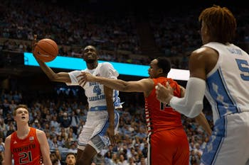 UNC senior guard Brandon Robison (4) attempts a shot during the game against Miami in the Smith Center on Saturday, Jan. 25, 2020. UNC defeated Miami 94-71.