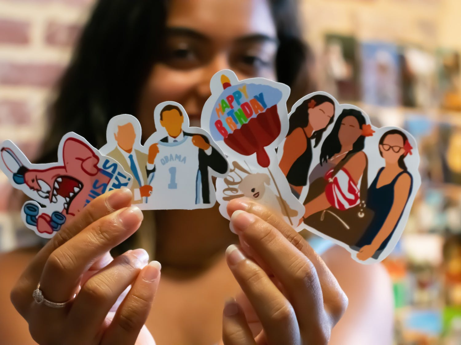 Prasiddhi Jain, Computer Science and Biostatistics senior and founder of The Printaholic, shows off the custom stickers she makes from her Chapel Hill apartment. Students around Chapel Hill are showing off their creativity by starting small businesses selling prints and stickers.