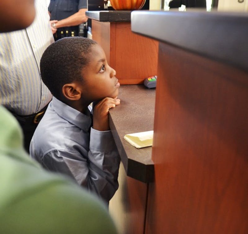5 year old Oliver watching as his parents' aplpication for a marriage license gets denied