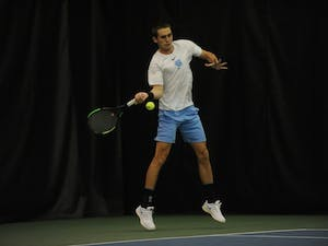 Sophomore Benjamin Sigouin, undeclared major, playing for the UNC men's tennis team against Duke on Jan. 26, 2019, in the Cone-Kenfield Tennis Center. UNC won 4-1 against Duke.