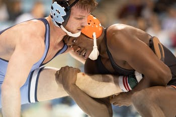 UNC redshirt senior A.C. Headlee and Princeton sophomore Quincy Monday wrestle in weight class 157 on Friday, Jan. 11, 2020 in Carmichael Arena. No. 17 UNC defeated No. 12 Princeton 25-11.