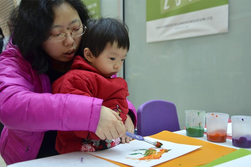 Kidzu Children's Museum partnered with Southern Village Pediatric Dentistry for an event at University Mall on Saturday morning. Carolina K. Wu, 24 months, practices painting with a toothbrush during the event.