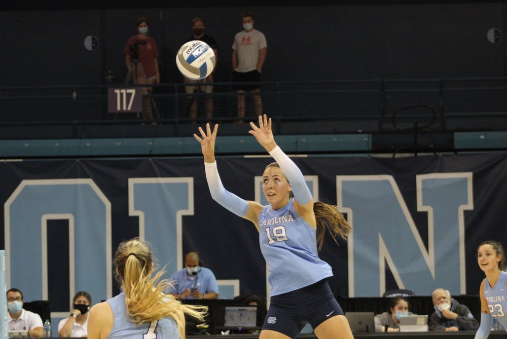 UNC graduate setter Emma Reynolds (19) returns a volley during a home match at Carmichael Arena on Sep. 17 against UNC Charlotte.