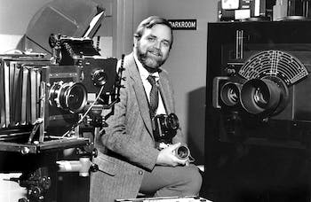"""Former DTH photojournalism David Wallace in 1983. Photo courtesy of Smithsonian Institution Archives, 2004-10337 or 83-16235, Created by Office of Printing and Photographic Services, """"James Wallace"""", 2004-10337_wk, Retrieved on 2020-06-30."""