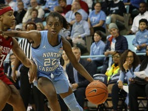 UNC senior guard Shayla Bennett (22) dribbles the ball while N.C. State junior guard Kai Crutchfield (3) attempts to block her during the UNC vs. N.C. State game on Thursday, Jan. 9, 2020 in Carmichael Arena. UNC won 66-60.