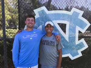 UNC first-year Casey Kania and junior Mark Dillon pictured after a match at the Elon Invitational on Sept. 26. Photo courtesy of UNC Athletic Communications.