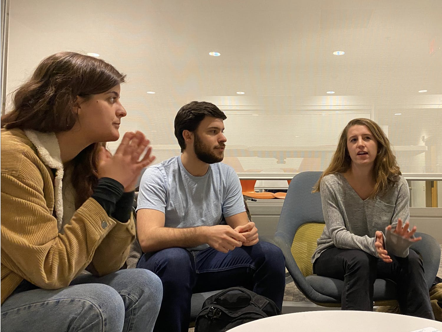 """UNC seniors Emily Shaljian, Ross DiBetta and Molly Crosswell are hoping to go on the biennial challenge, """"Red Bull Can You Make It,"""" set in early May. The competition flies selected teams to one of five cities in Europe. From there, each team must travel to Berlin without money or personal phones. For seven days, they are reliant solely on 24 cans of Red Bull as currency."""