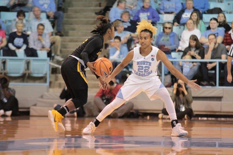 UNC guard Paris Kea (22) defends Appalachian State guard Tierra Wilson (3) in Carmichael Arena on Sunday night