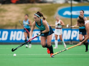 UNC Sophomore forward Erin Matson (1) dodges past Boston College player as she dribbles the ball towards the goal in the NCAA Final Four game against BC at Kentner Stadium on Friday, Nov. 22, 2019. UNC won 6-3, with four goals scored by Matson.