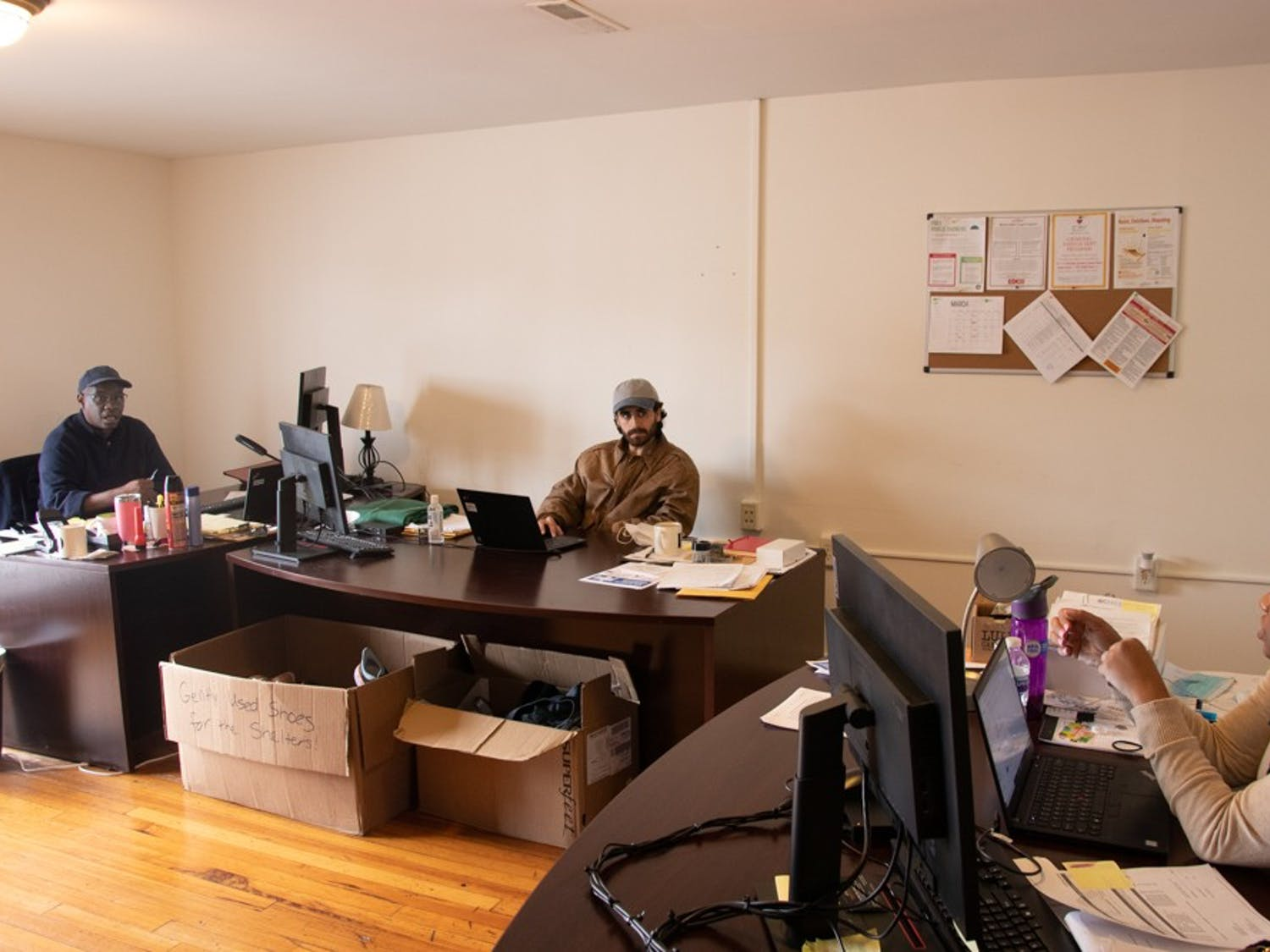 (From left to right) Don Hardin, Brandon Morande, and Tiffany Hall work together in the Orange County Street Outreach team office on 128 Franklin Street. The Street Outreach, Harm Reduction and Deflection program is a new program intending to aid people in the community who are experiencing homelessness.