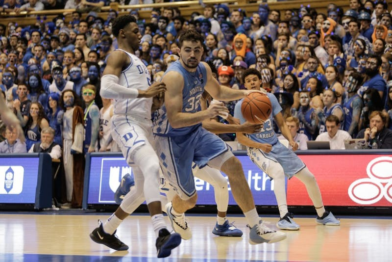 UNC forward Luke Maye (32) pushes past Duke forward R.J. Barrett (5) during Wednesday night's game at Cameron Indoor Stadium. Maye scored 30 points and had 15 rebounds.