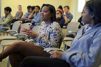 (From left to right) Asia Gandy, and Joia Freeman share their experiences with the attendees of the Token Black Girl Event Wednesday afternoon.