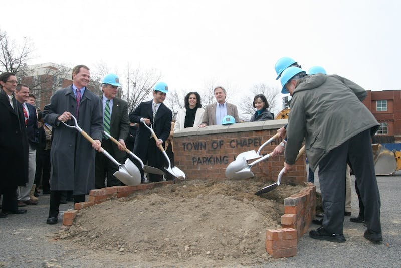 Chapel Hill officials and leaders of Ram Development Company work together to break ground on the 140 West Franklin multi-use development at a Jan. 5 ceremony. The new complex is slated to be completed in late 2012.