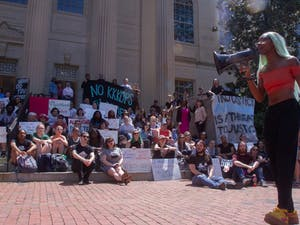 Students and activists gathered outside the Wilson Library at UNC-Chapel Hill on Wednesday, April 24, 2019. The activists protested UNC police and the University's treatment of student activists before and after the fall of Silent Sam. Various speakers discussed their personal experiences on campus and their interactions with police.