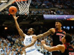 Senior guard Kenny Williams (24) shoots the ball during the game against Louisville at the Smith Center Saturday, Jan. 12, 2019. Louisville beat UNC 83-62.