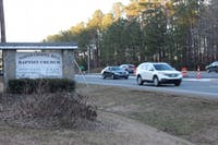 Cars drive by the entrance to North Chapel Hill Baptist Church, on Monday, Jan. 28, 2019, in Chapel Hill, NC. The church and it's adjacent graveyard, located at the intersection of Interstate 40 and Eubanks Road, will be effected if the North Carolina Department of Transportation keeps it's originally proposed Interstate 40 widening plan.