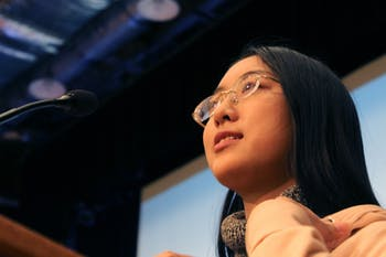 First-year international student Angela Wang, computer science and business major, standing at the microphone in the Great Hall in the Student Union on Wednesday, Jan. 23, 2019. The Great Hall is significant to Wang because she was the MC there for the Chinese Undergraduate Student Association Mid-Autumn Festival, which was one of the first events she participated in on campus. Wang's favorite Chinese New Year traditions include watching fireworks and the TV show 'Spring Festival Gala.' To celebrate the Chinese New Year Wang plans to video chat her family and attend events held by the Chines Undergraduate Student Association.