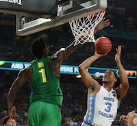 North Carolina forward Kennedy Meeks (3) shoots over Oregon forward Jordan Bell (1) in the teams' Final Four matchup on April 1 in Phoenix.
