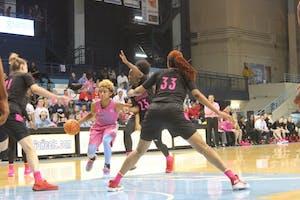 Guard Paris Kea (22) drives to the basket against Louisville on Feb. 18 in Carmichael Arena.