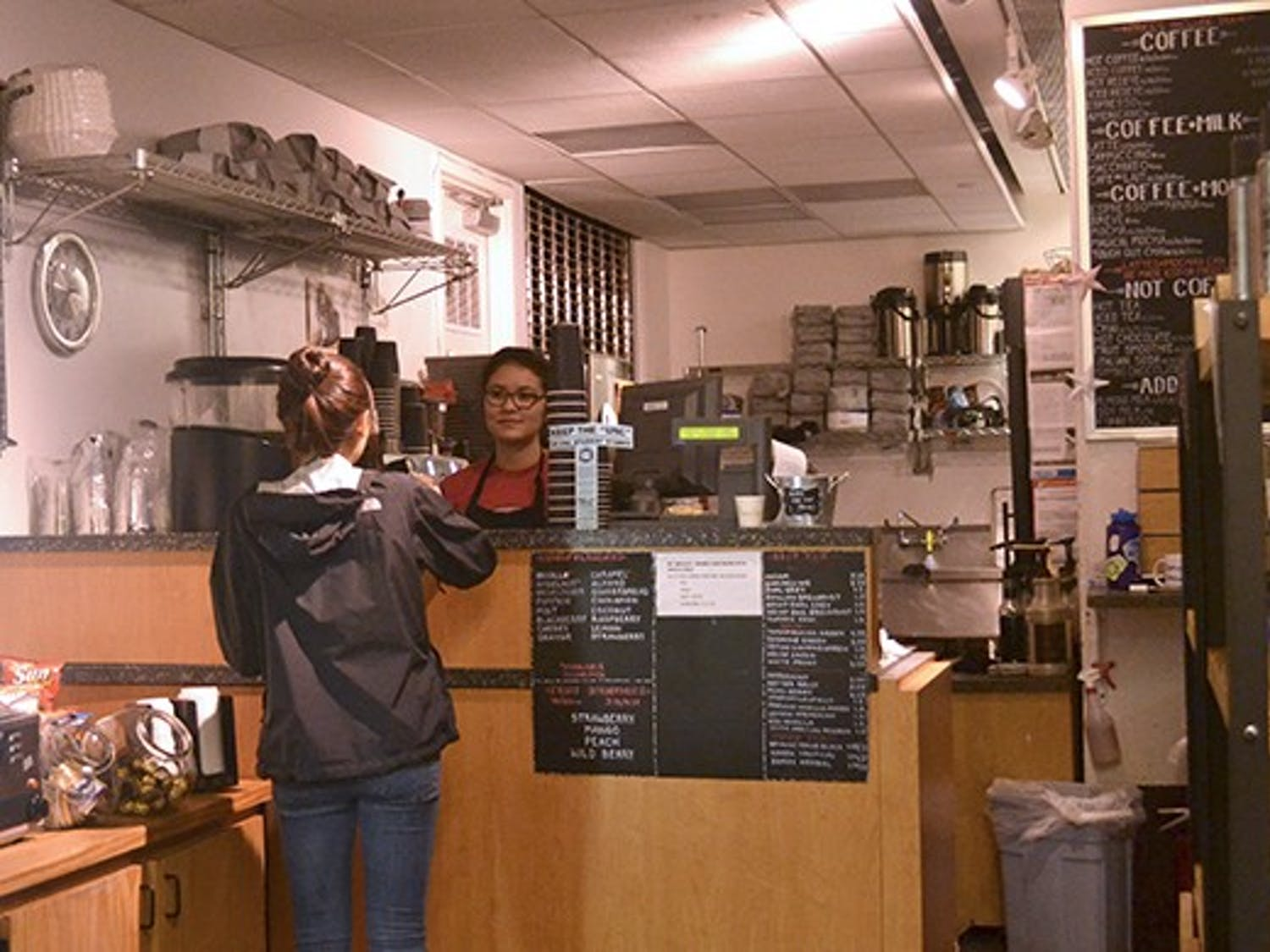 Stephanie Kim, a sophomore student, buys coffee from barista Mariko Davison at the Daily Grind located in the student store.