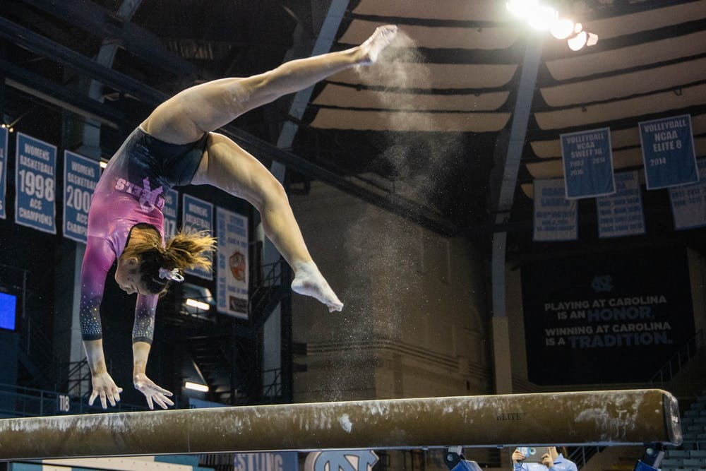 <p>Sophomore Emery Summey performs her beam routine during the gymnastics meet against the University of New Hampshire in Carmichael Arena on Monday, Feb. 17, 2020. The Tar Heels placed first against the Wildcats.</p>