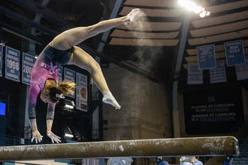 Sophomore Emery Summey performs her beam routine during the gymnastics meet against the University of New Hampshire in Carmichael Arena on Monday, Feb. 17, 2020. The Tar Heels placed first against the Wildcats.