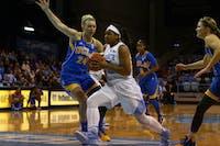 UNC guard Allisha Gray (15) runs the ball down the court.