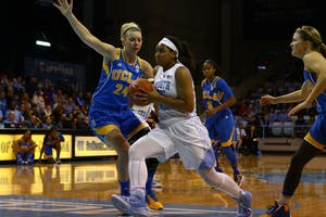 UNC guard Allisha Gray (15) runs the ball down the court in a game against UCLA on Nov. 16.