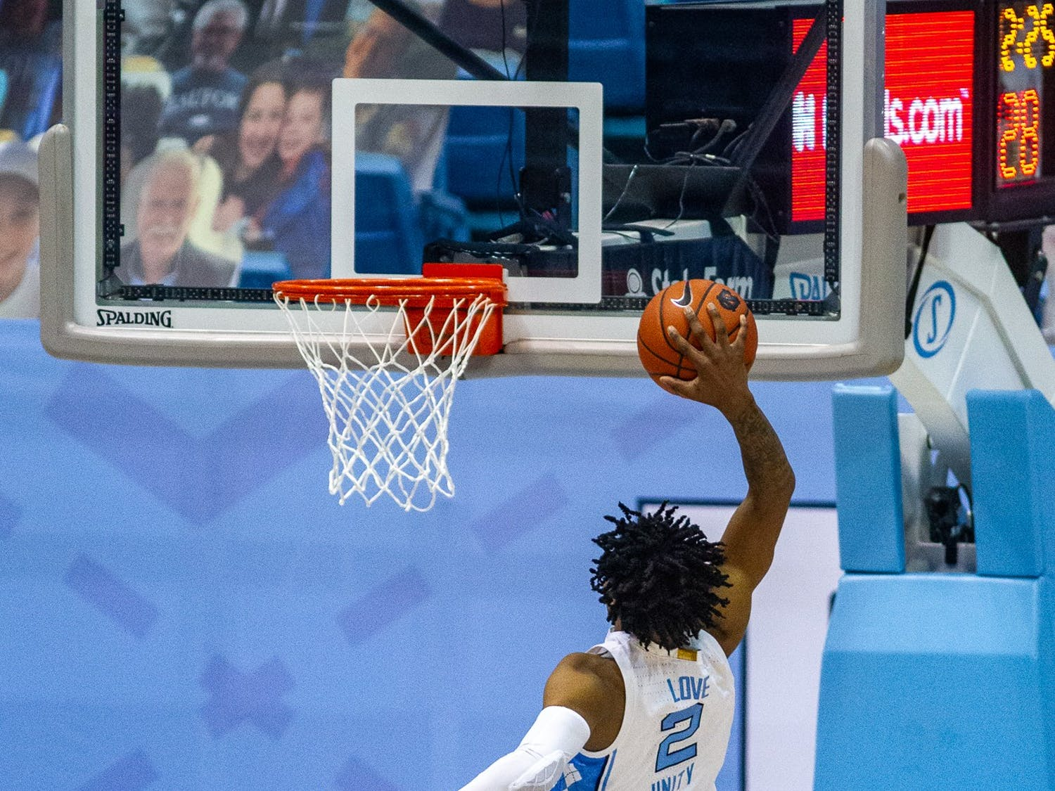 UNC freshman guard Caleb Love (2) dunks in the Dean Smith Center on Jan. 20, 2021 during a game against Wake Forest. The Tar Heels beat the Demon Deacons 80-73.