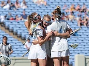 The North Carolina women's lacrosse team celebrates a goal against Duke on April 21 at Kenan Stadium.