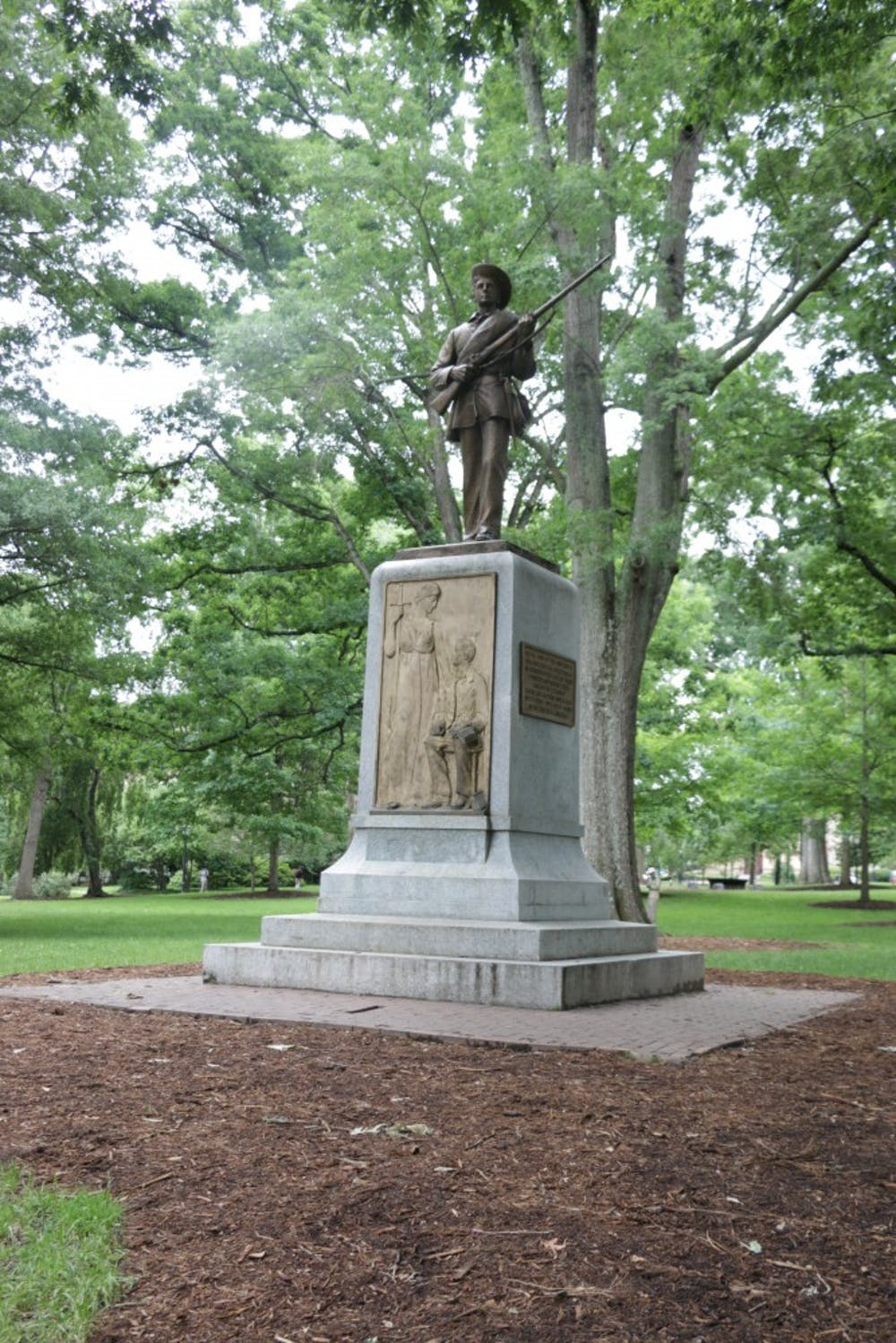 <p>The Silent Sam statue looks towards Franklin Street from its location in the Upper Quad on UNC's campus.</p>