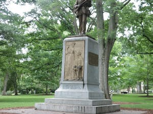 The Silent Sam statue looks towards Franklin Street from its location in the Upper Quad on UNC's campus.