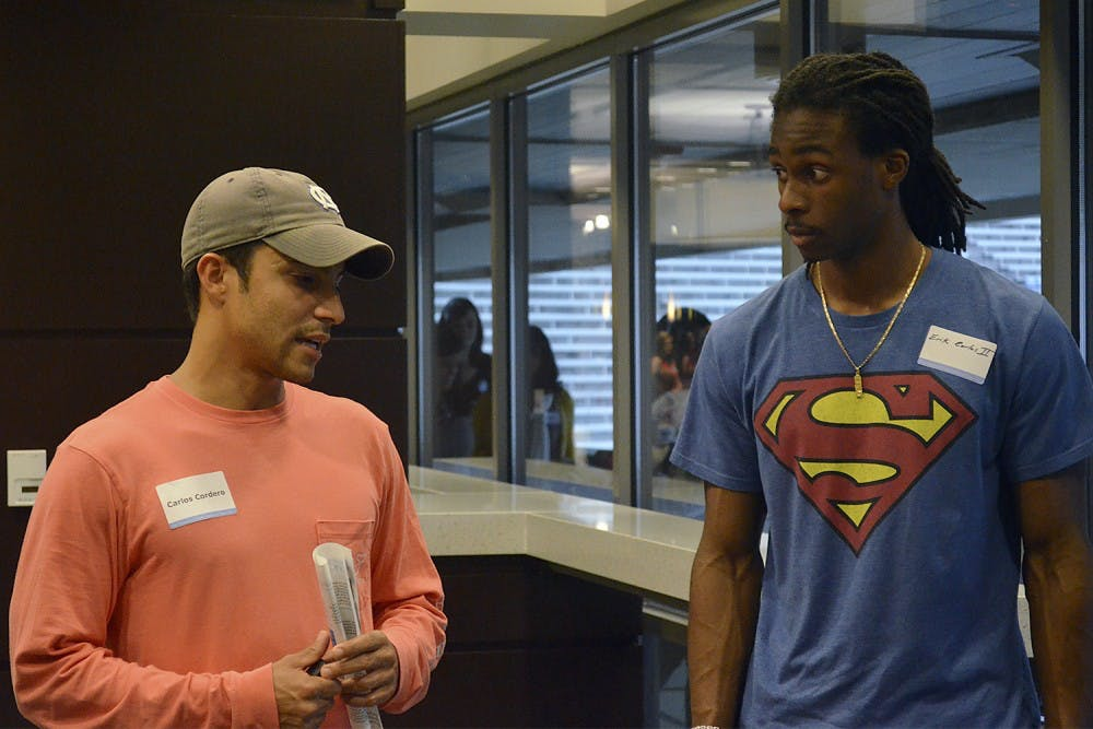Carlos Cordero, left, 29, is in his first year at UNC.  As a staff sergeant in the Army, he was stationed at Fort Bragg.  Through Fayetteville Technical Community College, he joined C-Step which led him to UNC Chapel Hill.