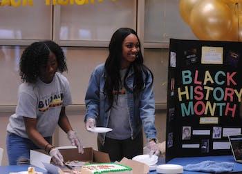 UNC sophomores Jasmine Marshall and Faith Jeffers help the Black Student Movement kickoff Black History Month in the Carolina Union on Friday, Feb. 1, 2019.