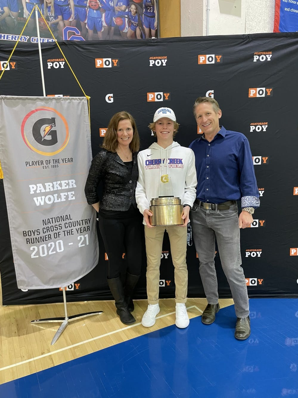 Parker Wolfe, one of UNC track and field's top recruits, smiles with his family after being awarded the Gatorade National Boys Cross Country Runner of the Year at Cherry Creek High School. Photo courtesy of Luke Akinsola.