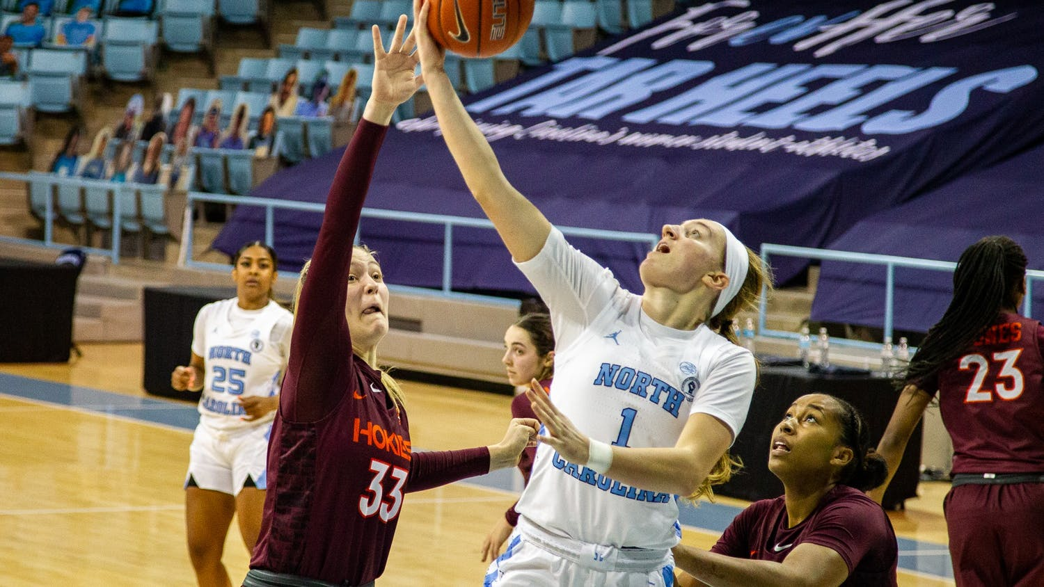 UNC freshman guard Alyssa Utsby (1) does a layup in Carmichael Arena on Jan. 14, 2021 in Chapel Hill, N.C. The Tar Heels lost to the Hokies 66-54.