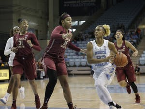 UNC Guard Paris Kea (22) shoots against FSU in Carmichael Arena on Sunday, Jan. 6, 2019. UNC lost 63-64.