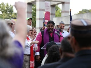 Rev. Dr. William J. Barber II speaks about the history of voters' rights in the U.S. at the rally on Thursday. 