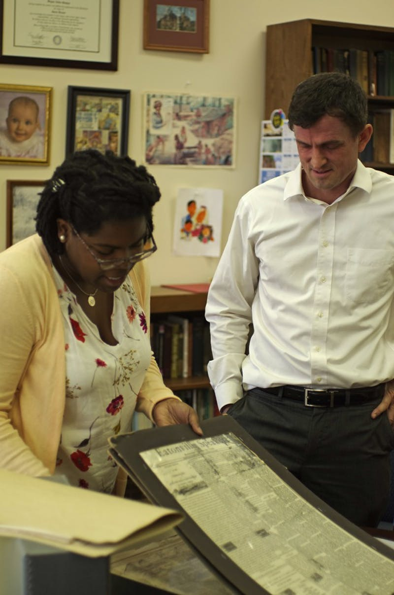Chaitra Powell and Bryan Giemza look through archives that will be included in the Collection