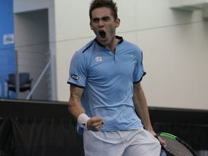 UNC's Benjamin Sigouin celebrates during a Feb. 5 match against Texas Christian in the Cone-Kenfield Tennis Center.