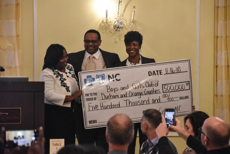 Jerome Levisy accepts a check from Blue Cross Blue Shield on behalf of the Boys and Girls Club of Durham and Orange Counties at the Celebration of Youth event on Friday morning